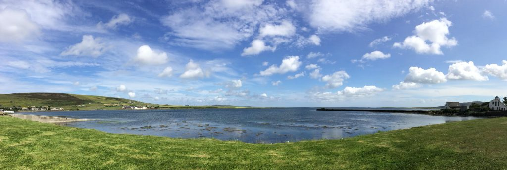 Kirkwall panographic image of meadow and loch